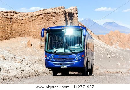 Blue Touristic Bus At The Background Of The Amphitheater In The Moon Valley
