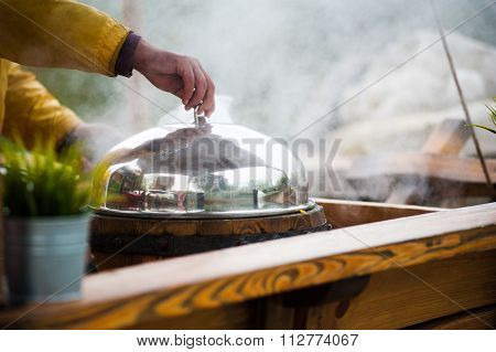 Street Food In The City - Shopkeeper Is Covering A Pot Of Steaming Fresh Corn With Cap