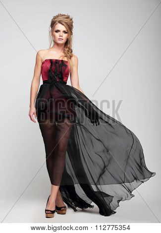 Blond Girl In Long Dress.