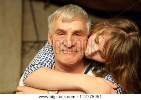 Granddaughter Kissing Her Grandfather