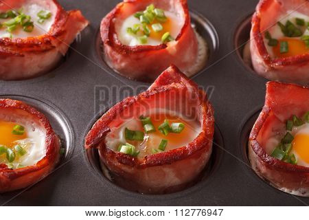 From The Oven Eggs Wrapped In Bacon Close Up In Baking Dish. Horizontal
