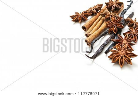 Star anise, cinnamon and vanilla bean on white background