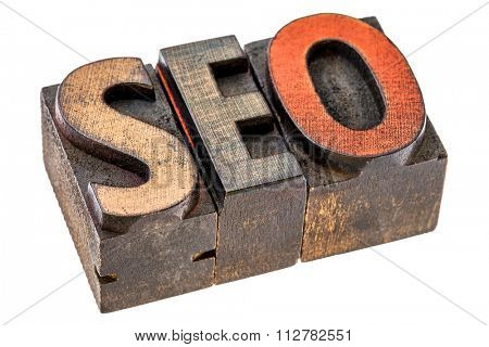search engine optimization (SEO) - isolated acronym  in vintage letterpress wood type printing blocks stained by color inks