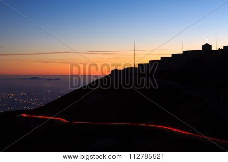 Light Trails With Building In Silhouette.