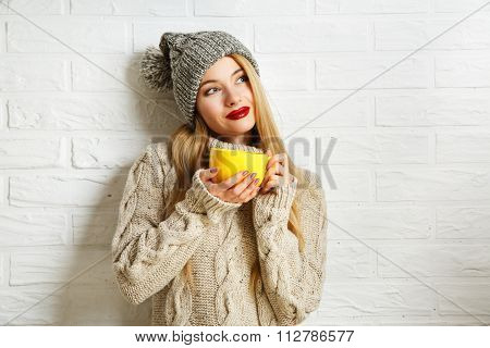 Romantic Dreaming Winter Hipster Girl with a Mug