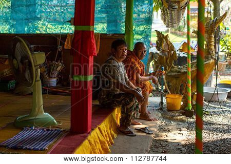 KO CHANG - THAILAND - DEC 29, 2015: Unidentified local monk in the Wat Khlong Prao monastery on the island. Koh Chang one of the largest Islands of Thailand, located of 310 km from Bangkok.