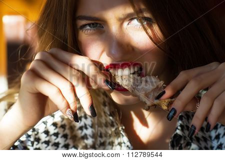 Girl Eating Meat