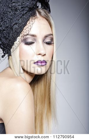 Gorgeous Model Wearing A Hat With Veil