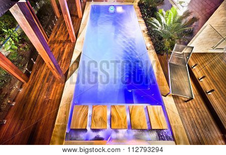 A Stunning And Beautiful Picture Of A Hosue Pool From Top