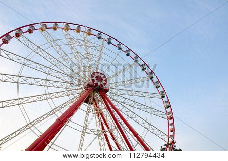 Ferris Wheel With Cabins On The Background Of Cirrus Clouds. A Horizontal View