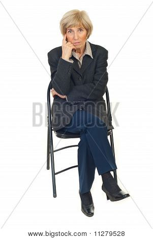 Serious Senior Business Woman On Chair