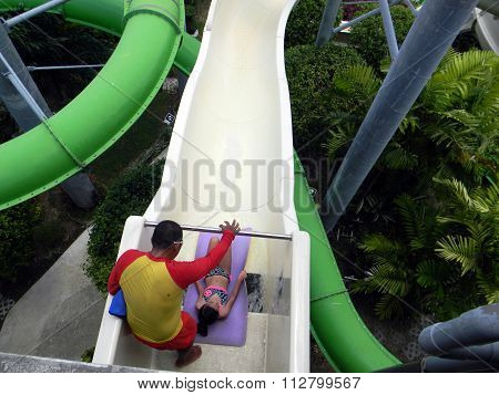 Girl Prepares to Slide