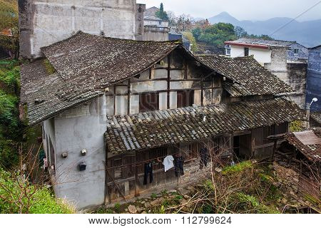Ruined farmhouse in traditional chineese village