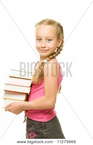 Happy little schoolgirl with a stack of heavy books