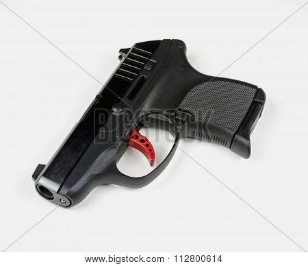 Small Handgun with Red Trigger