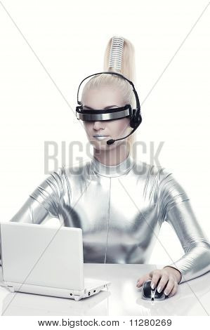 Beautiful cyber woman working on a her laprop