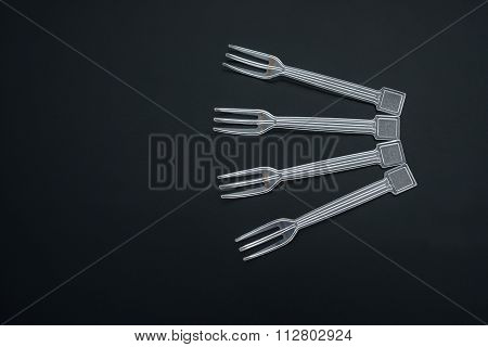 4 Plastic Disposal Forks On Black