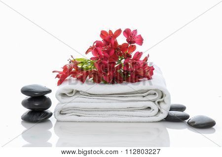 Objects for Spa-orchid on towel. black stones