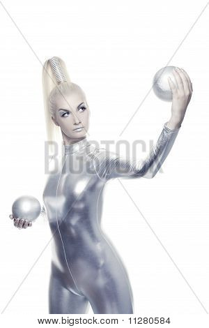Beautiful blond cyber woman with a silver balls