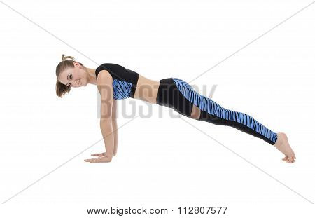 Studio image of pretty smiling girl doing push-ups