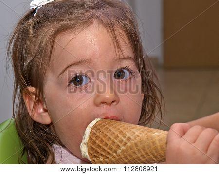 Cute Toddler Girl Eating Ice Cream