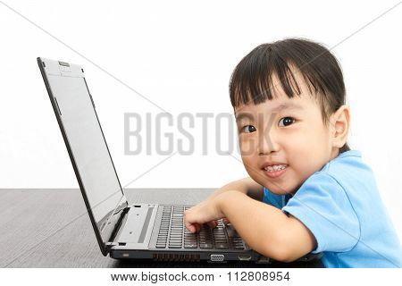 Chinese Little Girl Using Laptop