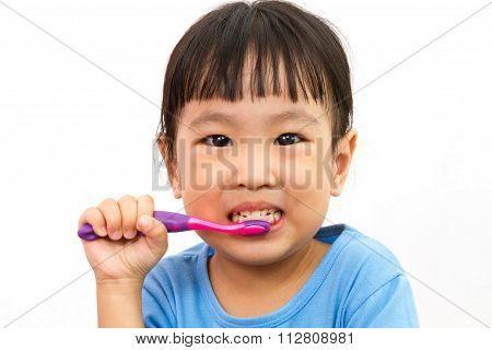 Chinese Little Girl Brushing Teeth