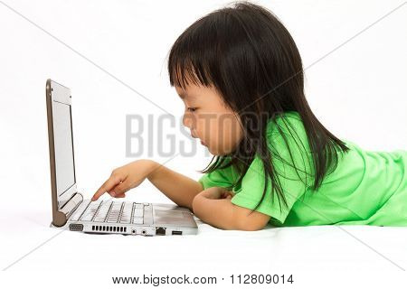 Chinese Little Girl Lying Down With Laptop