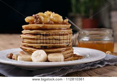 Pancakes With Caramelized Banana, Nuts And Honey