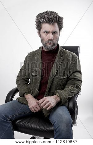 Mr. IceMan aggression, he hold the phone . fashion man in knitted sweater and jacket.