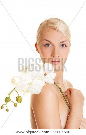 Beautiful young woman with a white orchid