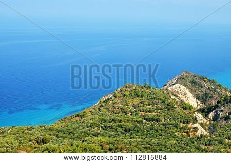Green mountain and blue sea