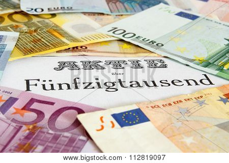 Share outlined with Euro banknotes