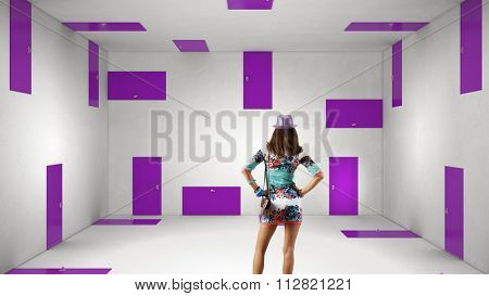 Woman wearing colorful dress in room choosing one of plenty of doors