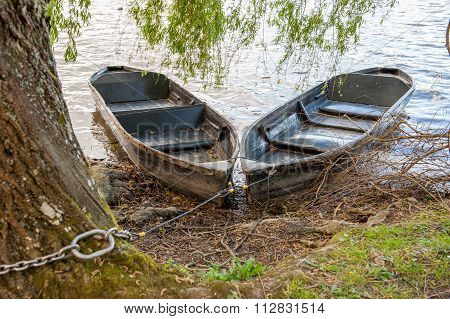 Two wooden rowing boats