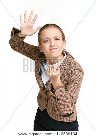 Angry businesswoman showing fist in isolation