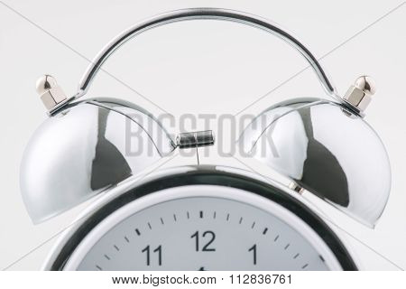 Close up of alarm clock on the surface.
