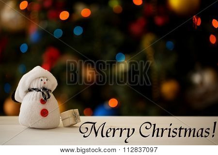 Snowman on a Christmas tree background with inscription