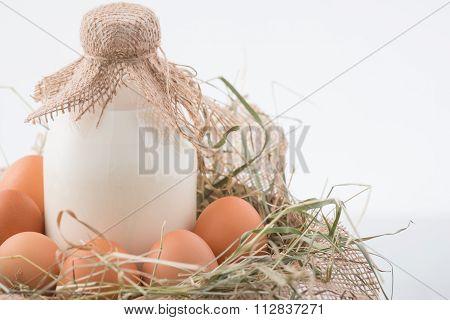 Eggs and milk are in decorative nest.