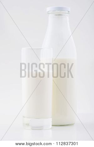 Bottle and glass of milk together.