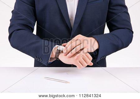 Businessperson adjusting his wristwatch.