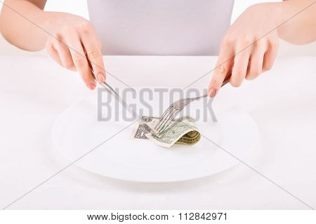 Woman with dinnerware and one dollar.