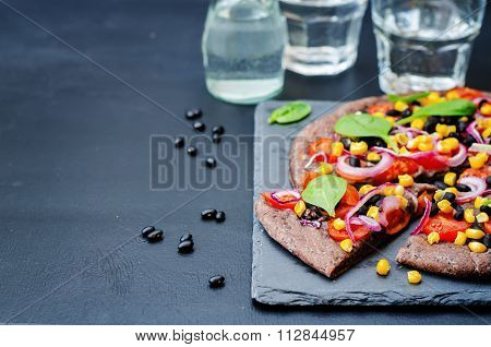 Black Beans Crust Pizza With Corn, Spinach, Tomatoes, Black Beans And Red Onion