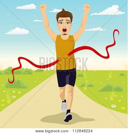 male runner crossing red finish line outdoors