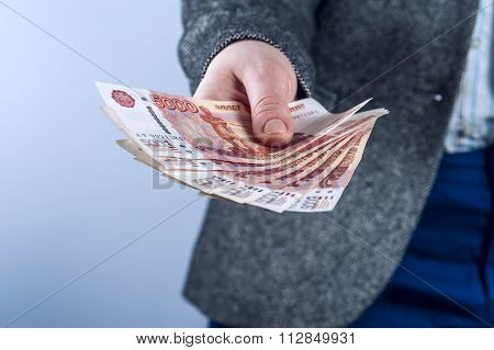 Businesswoman holds Russian rubles.