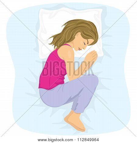 woman sleeping in the fetal position