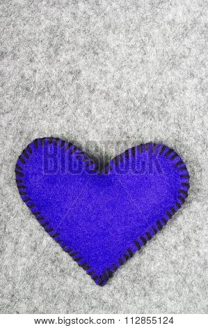 blue heart on grey background