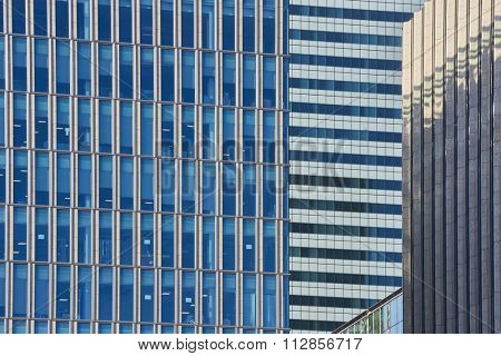Close up cropped shot of skyscraper window frames in blue metal.