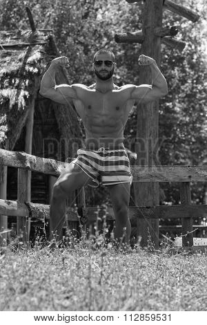Man Showing His Well Trained Body Outdoors