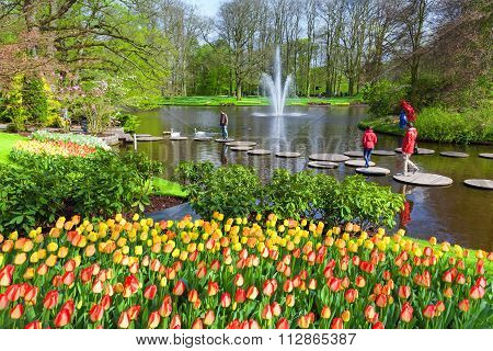 Pond and flowering tulips at Keukenhof Gardens, Netherlnads.